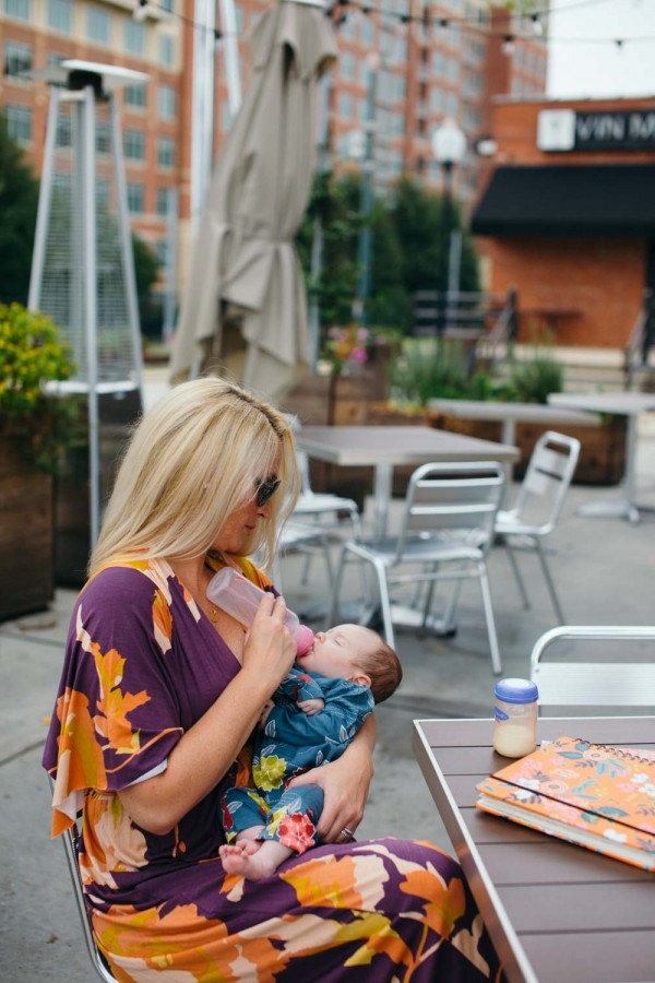 Kate Brennan wearing Rachel Pally while feeding her daughter Summer Brennan with a Dr. Browns bottle