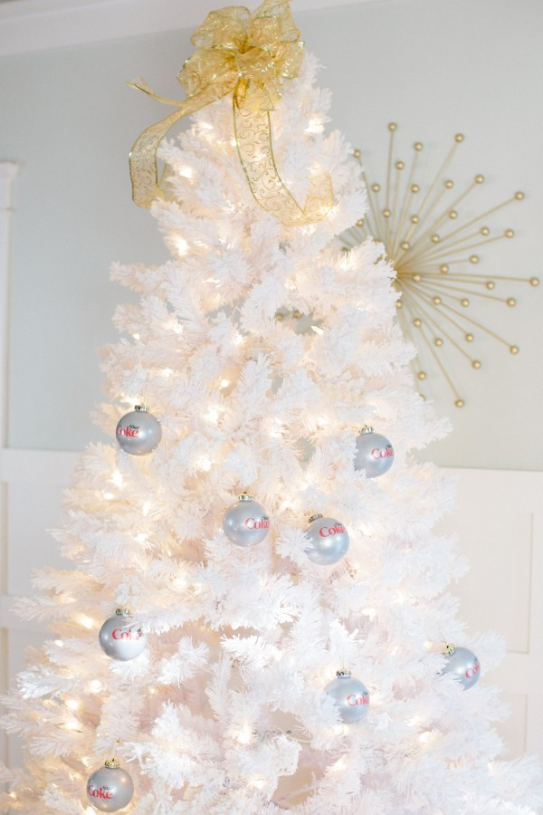 A festive White Christmas Tree Decorated with Diet Coke Ornaments