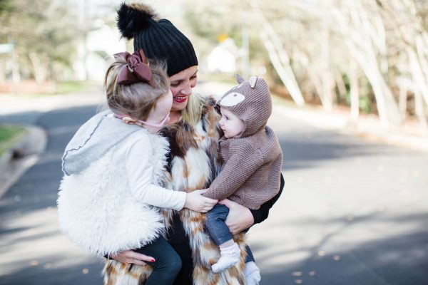 Blogger Kate Brennan holds her daughters Summer and Isabella in her arms